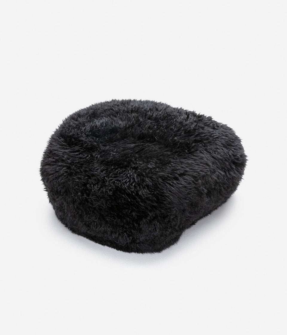 Grey sheepskin footstool