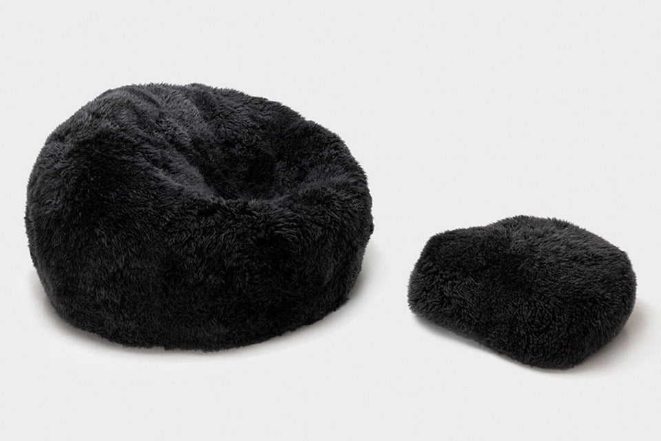 Grey sheepskin bean bag chair and sheepskin footstool
