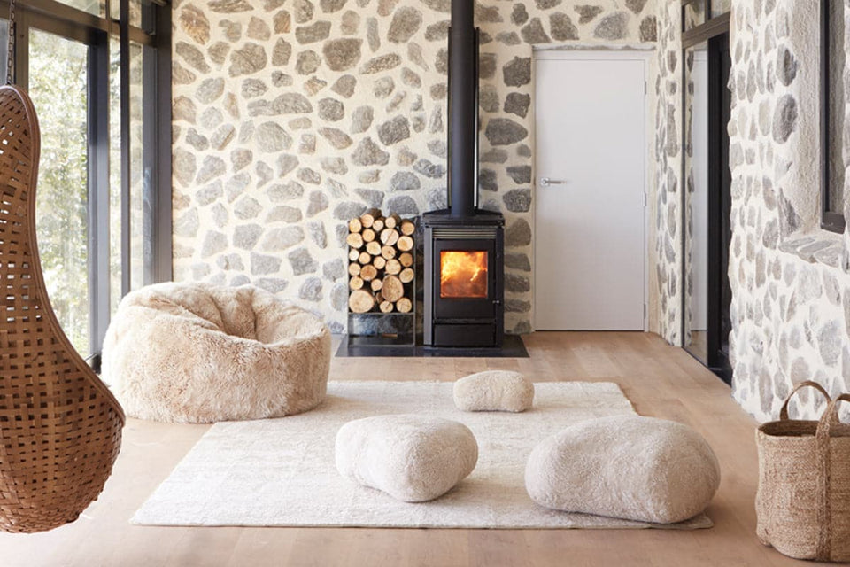 Scandi living area with a fire place and sheepskin furniture
