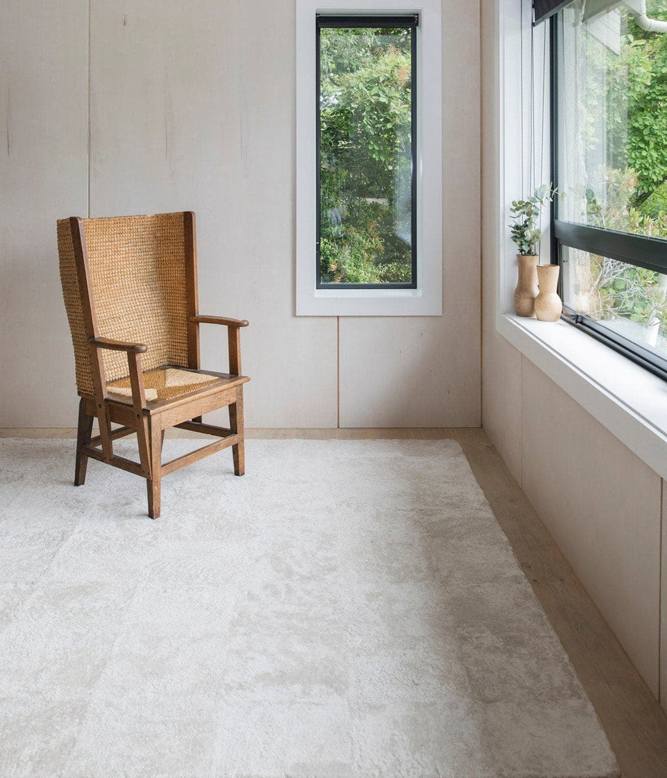 Minimalist interior with a short wool sheepskin floor rug