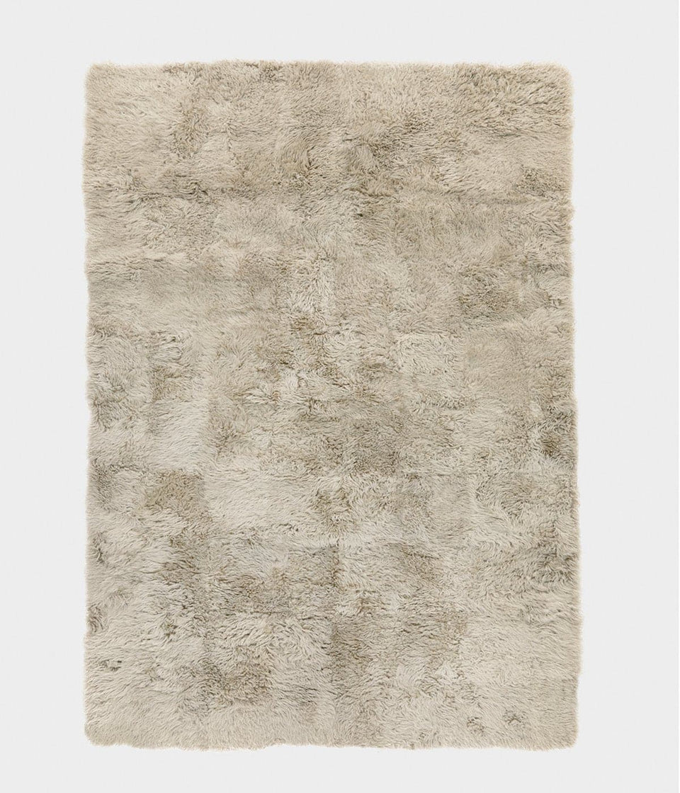 Natural coloured rectangular sheepskin wool floor rug