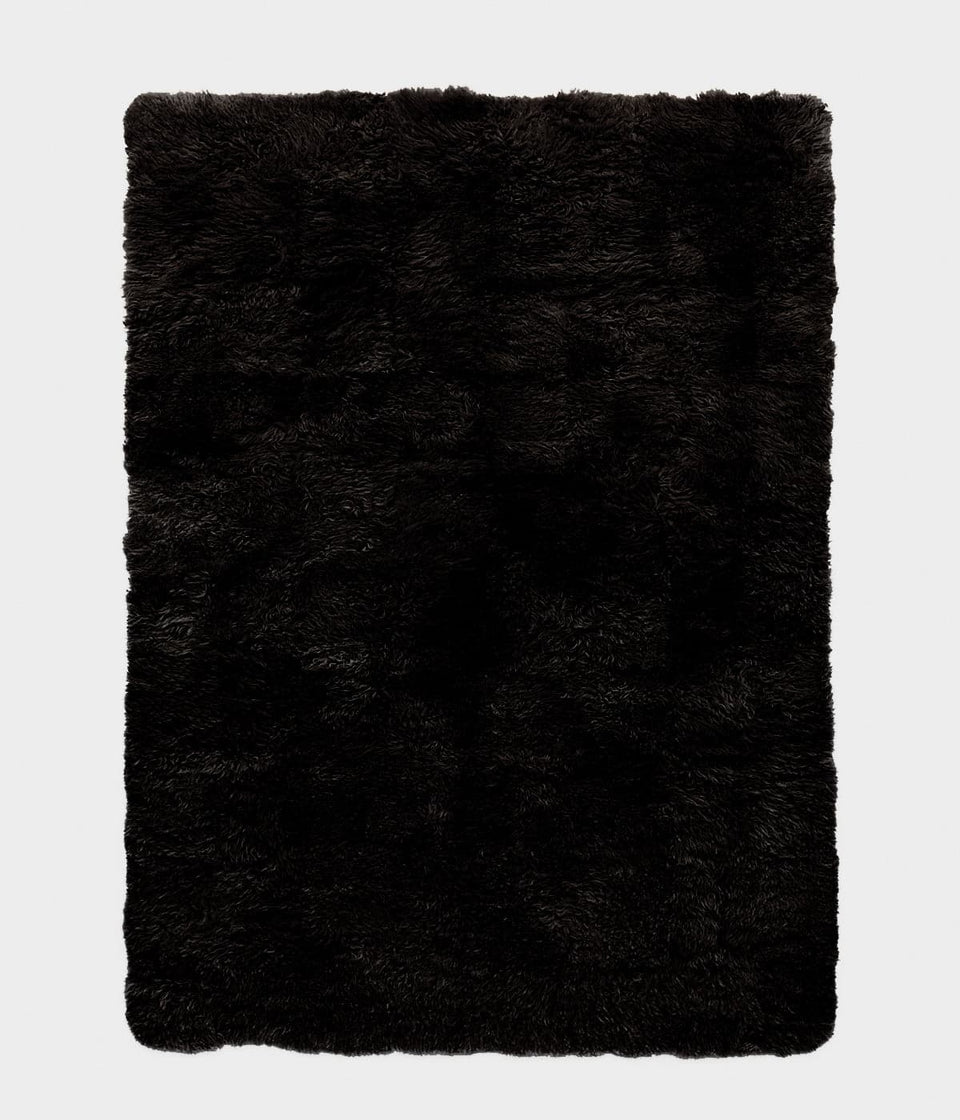 Black rectangular sheepskin wool floor rug