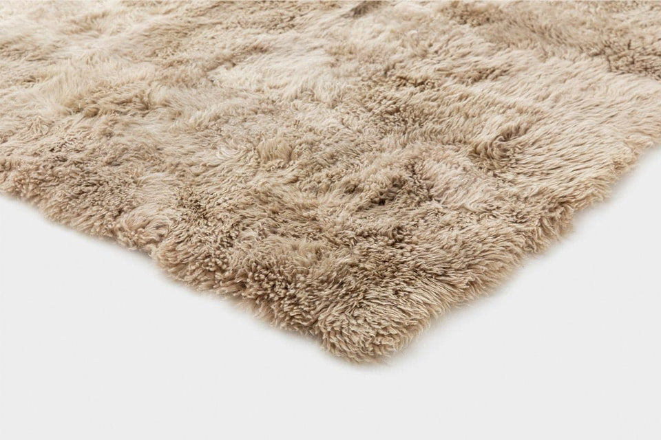 Closeup on a corner of a sheepskin wool floor rug