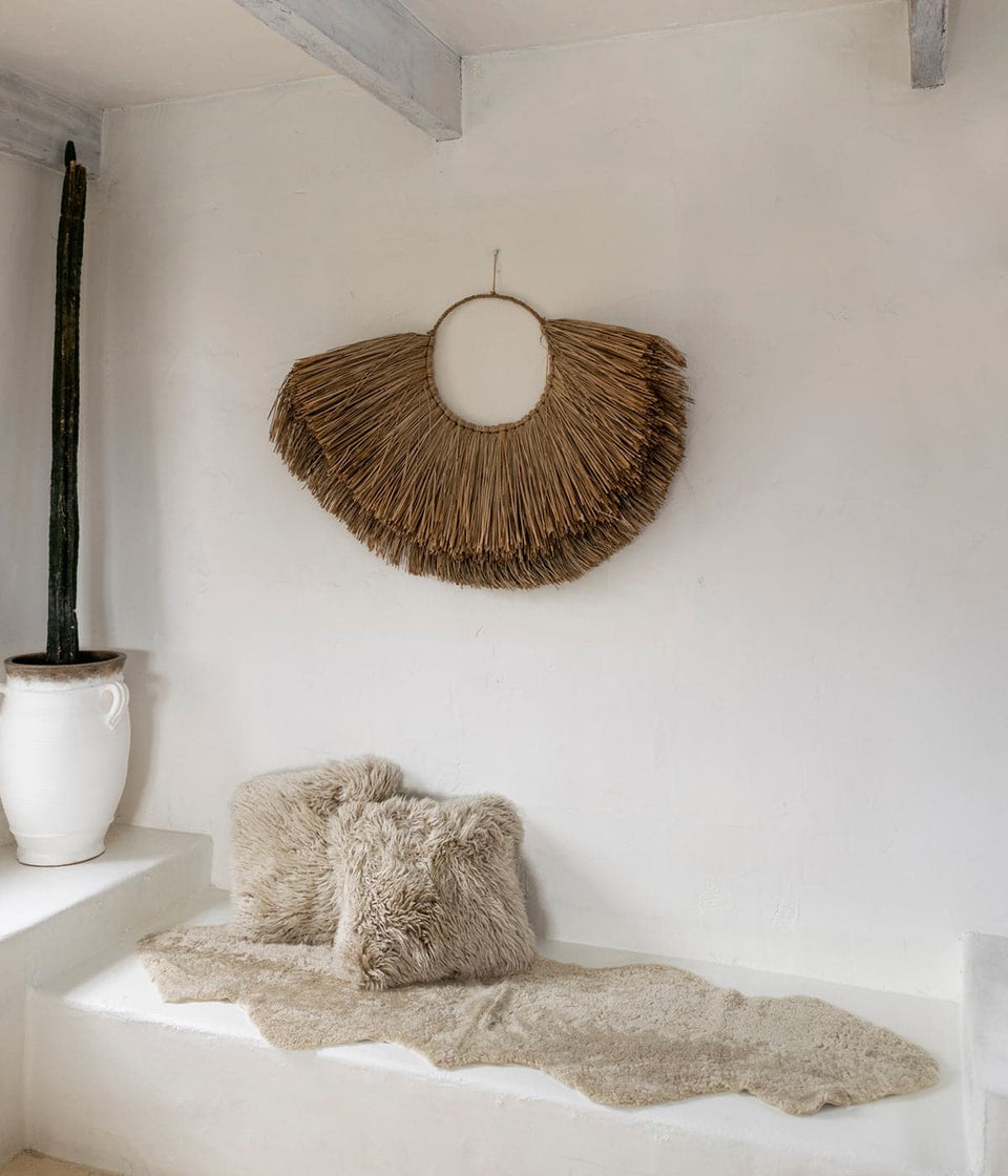 Short wool sheepskin rug on a white bench seat