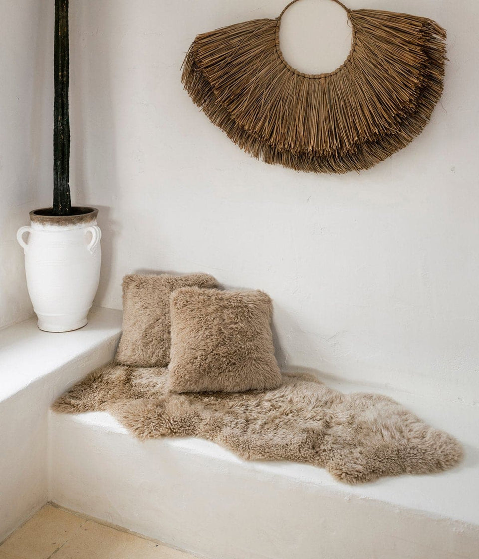 New Zealand long wool Sheepskin rug and sheepskin cushions on bench seat