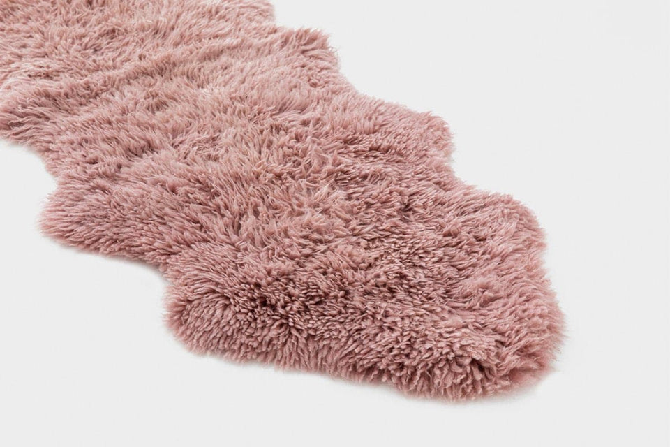Pink long wool sheepskin rug