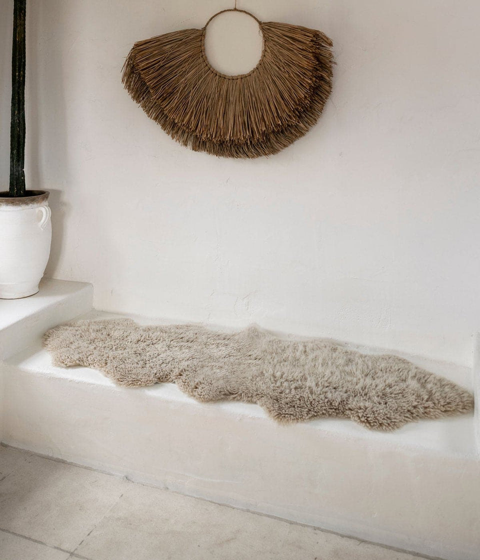 Sheepskin rug on a white bench seat
