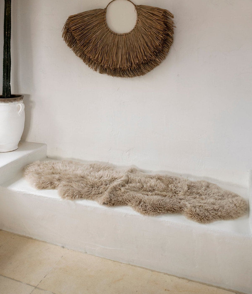New zealand sheepskin rug on bench seat