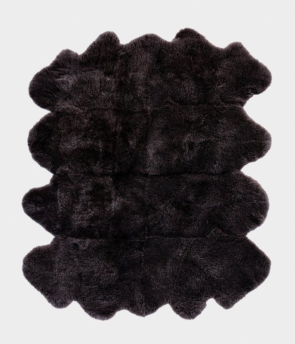 Large black long wool sheepskin rug