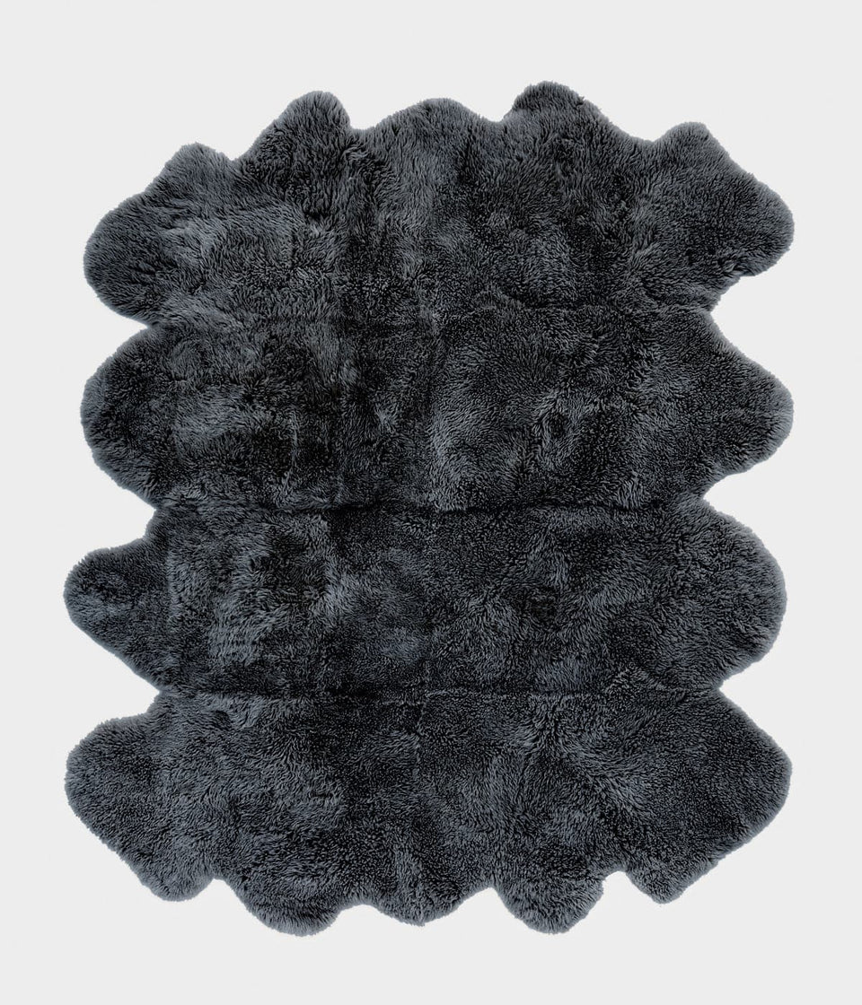 Dark grey sheepskin floor rug
