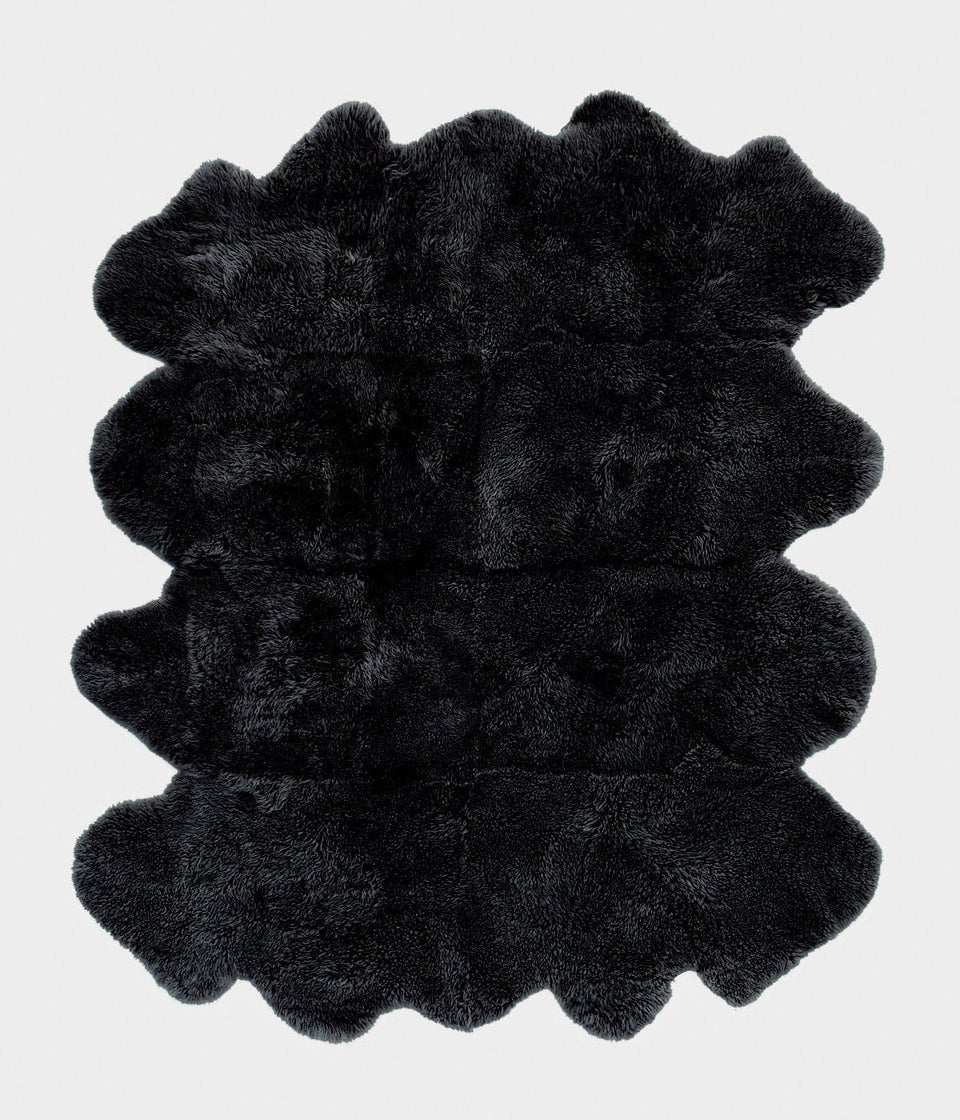 Large dark grey long wool sheepskin rug