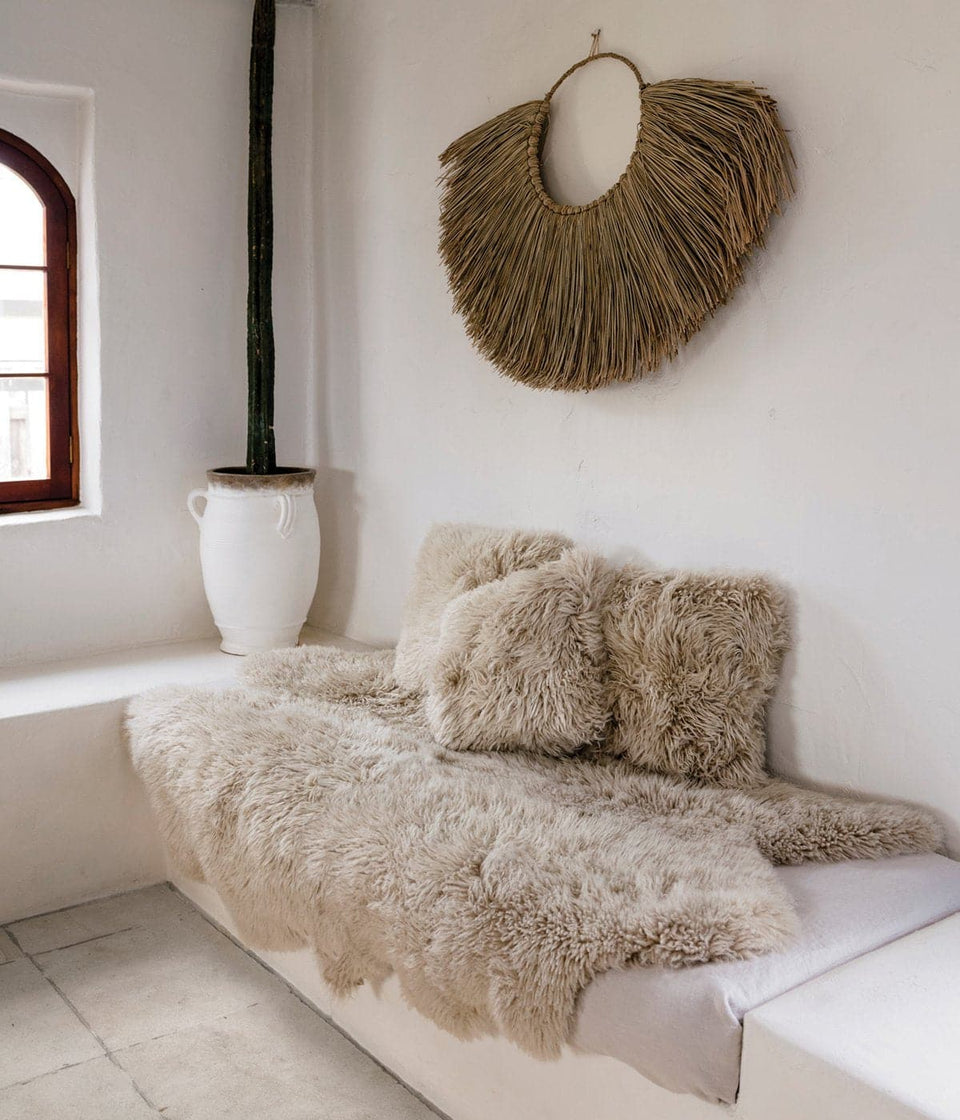 New Zealand sheepskin rug on window seat