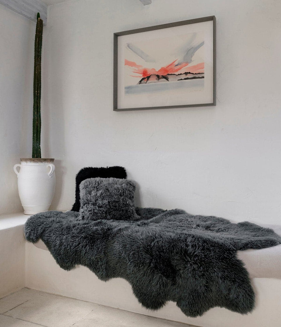 Grey sheepskin rug in a white interior
