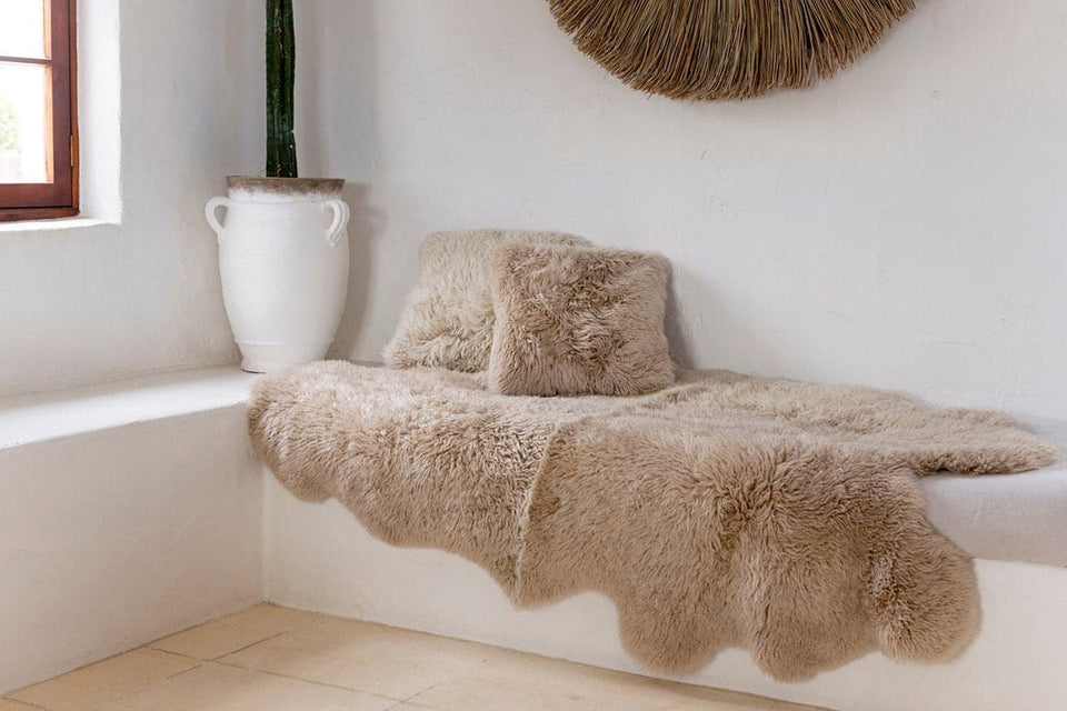 New Zealand long wool sheepskin rug on white bench seat