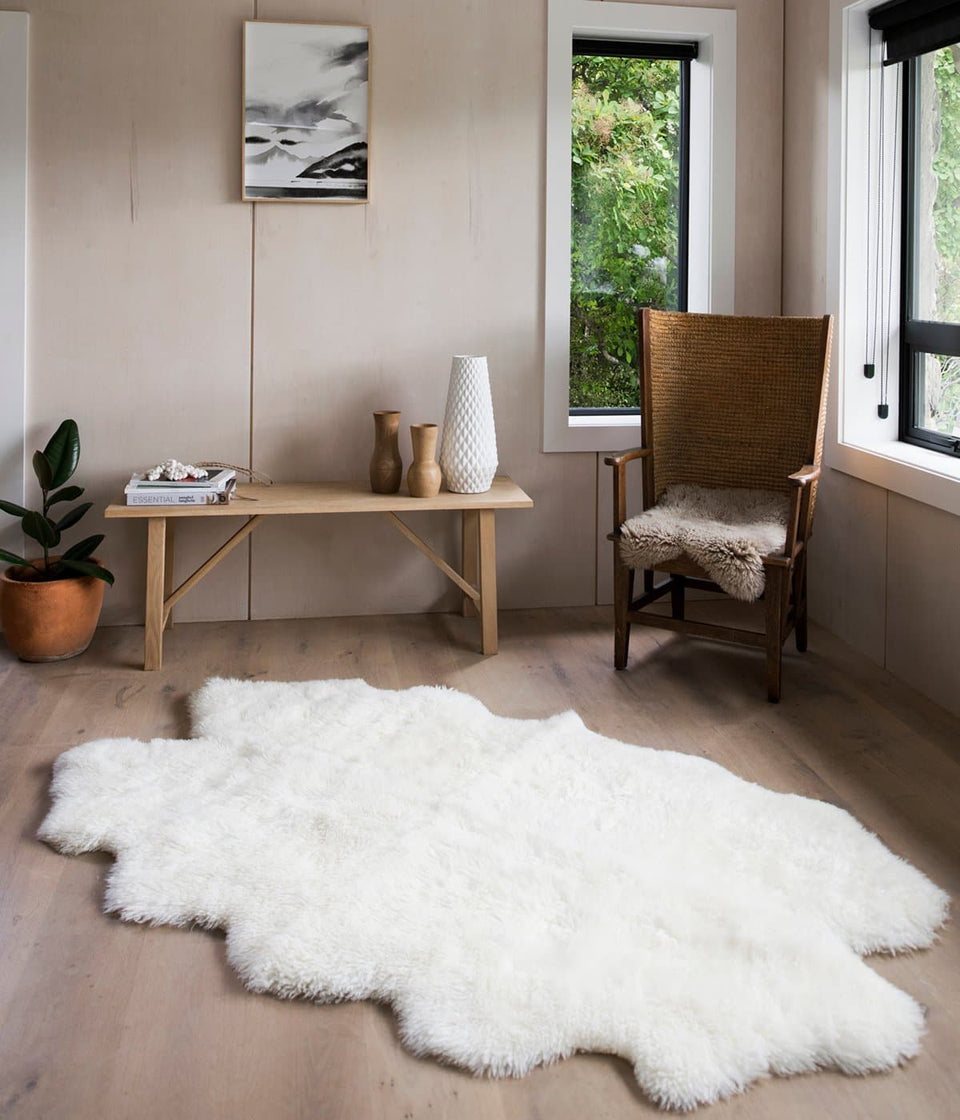 White long wool new zealand sheepskin rug in a sunny minimalist room