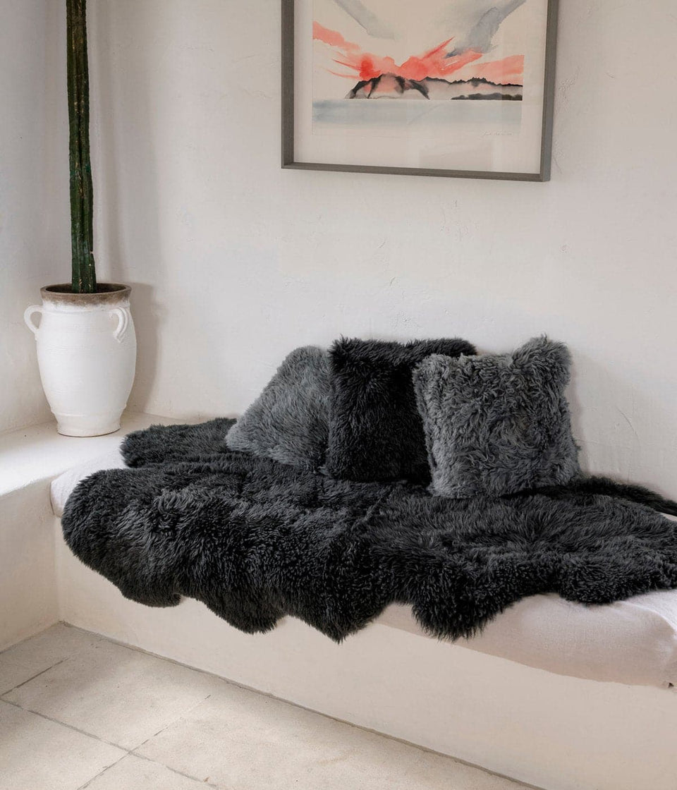 New Zealand long wool sheepskin rug and cushions on bench seat