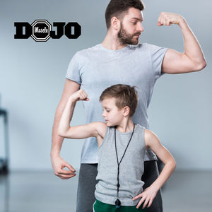 Man and son flexing