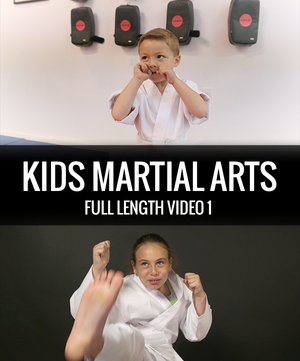 A young boy with his hands up martial arts, and a young pre teen girl throwing a karate kick.