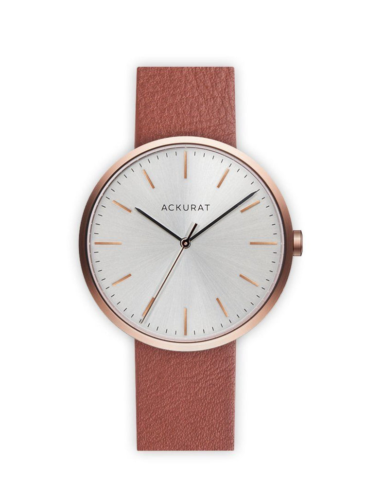 Minimalist watch in rosé gold with a tan leather strap