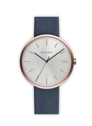 Minimalist watch in rosé gold with a blue leather strap