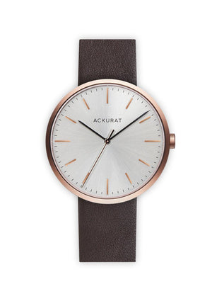 Minimalist watch in rosé gold with a brown leather strap