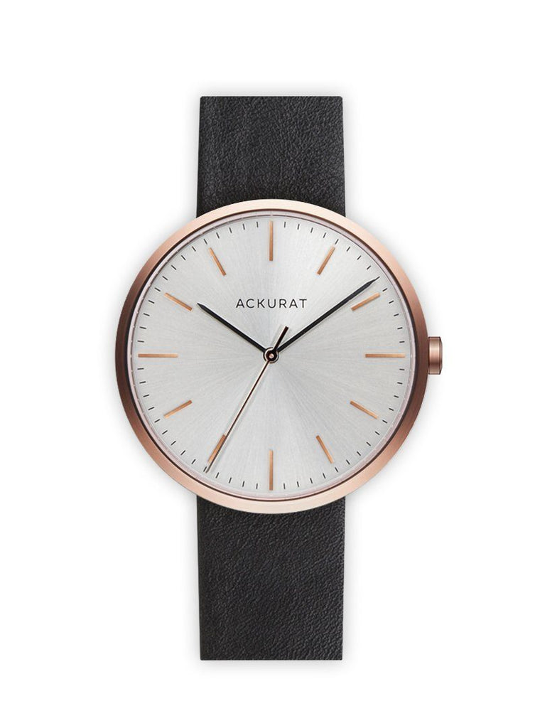 Minimalist watch in rosé gold with a black leather strap