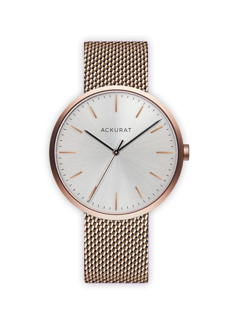 Minimalist watch in rosé gold with a milanese mesh strap