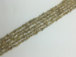 Rutilated Quartz Gold G1 Chips 16 Inch 5-8Mm