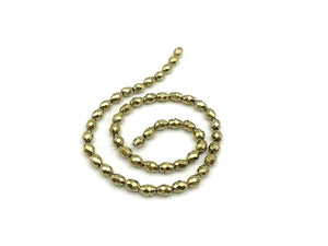 Hematite Coated Light Gold Faceted Rice 4X6Mm