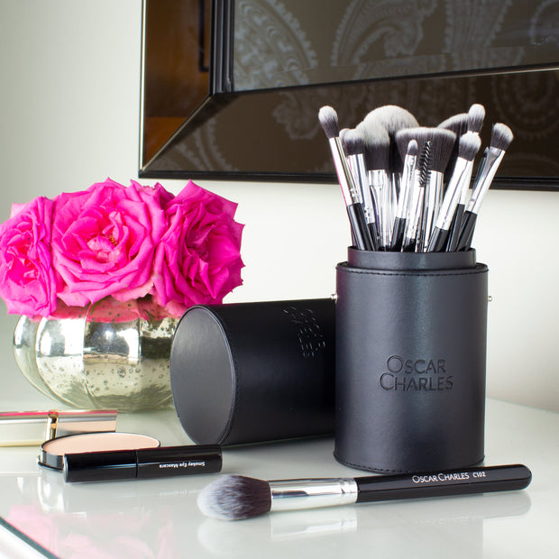 oscar charles 17 piece makeup brush set in silver on dressing table