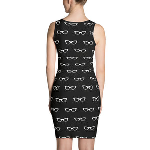 back side of black pencil dress with a pattern of white vintage eyeglasses