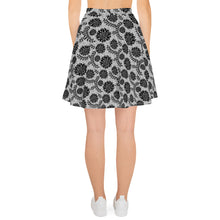 Load image into Gallery viewer, back side of white skater skirt with a pattern of black flowers on top of circuit background