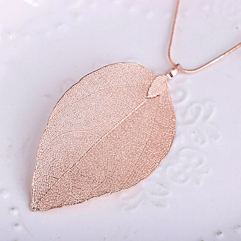products/2018-Sweater-Coat-Necklaces-Ladies-Girls-Special-Leaves-Leaf-sweater-Pendant-Necklace-Long-Chain-Jewelry-for_284c1379-312b-4107-8ca5-98f93eeddb4e.jpg