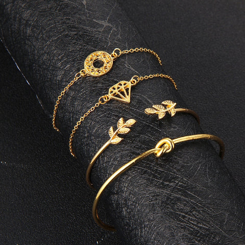 products/Tocona-4pcs-Set-Fashion-Bohemia-Leaf-Knot-Hand-Cuff-Link-Chain-Charm-Bracelet-Bangle-for-Women_0411d8e7-c147-4fd5-84c2-219b4e8b8f34.jpg