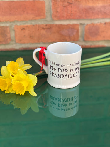 """The dog is my grandchild"" mug"