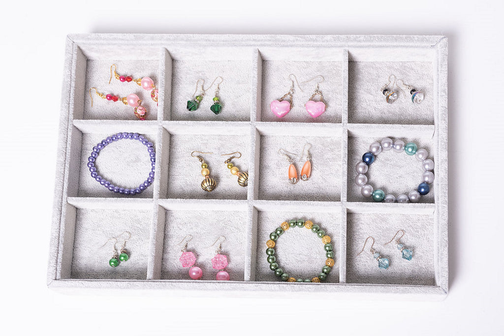 earrings and bracelets in a box in different jewellery colours and patterns