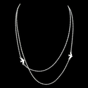 The silver Kelabu double layer necklace with beautiful bird charm on a black background