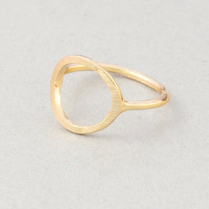 The Kelabu Karma Circle bohemian rings in Gold on a light coloured background