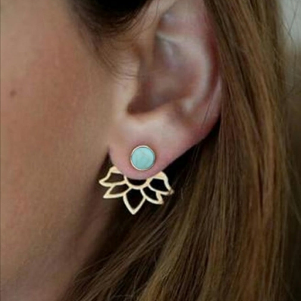 Woman with hair down wearing the Kelabu silver and turquoise gem behind the ear earrings