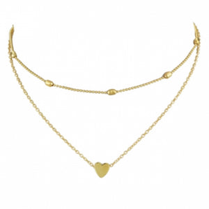 The beautiful Kelabu gold heart charm necklace and choker set pictured on a plain white background