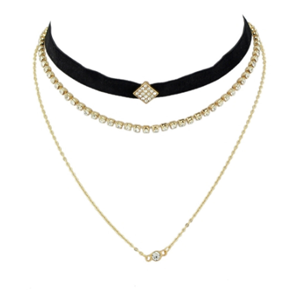 The stylish layered choker from Kelabu, with velvet, gold and crystal designs, on a plain white background
