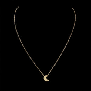 The Kelabu dainty moon pendant necklace in Gold on a black background