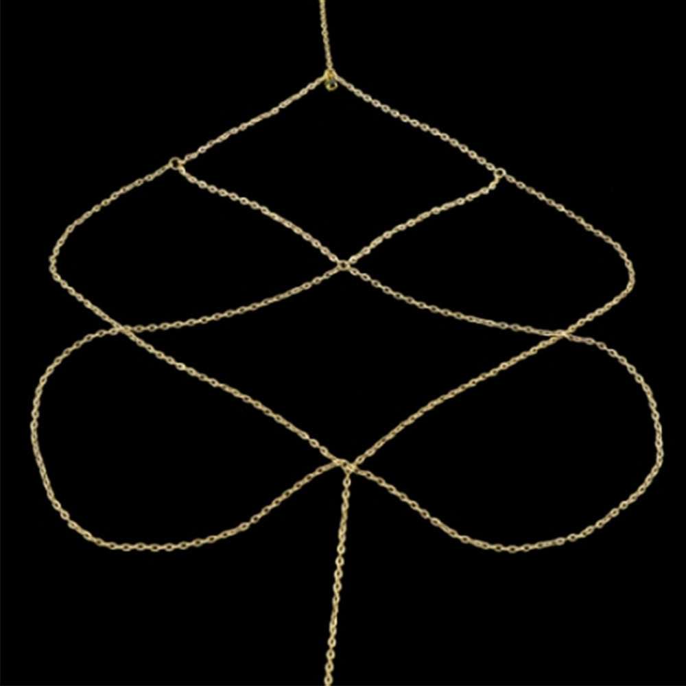 The Kelabu diamond detail leg chain in gold laid out flat on a black background