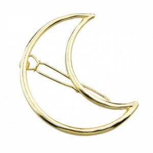 Close up image of the Kelabu cut out moon hair clip in Gold