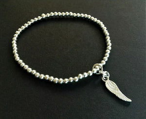 Silver Ball Stacking Bracelet With Angel Wing Charm