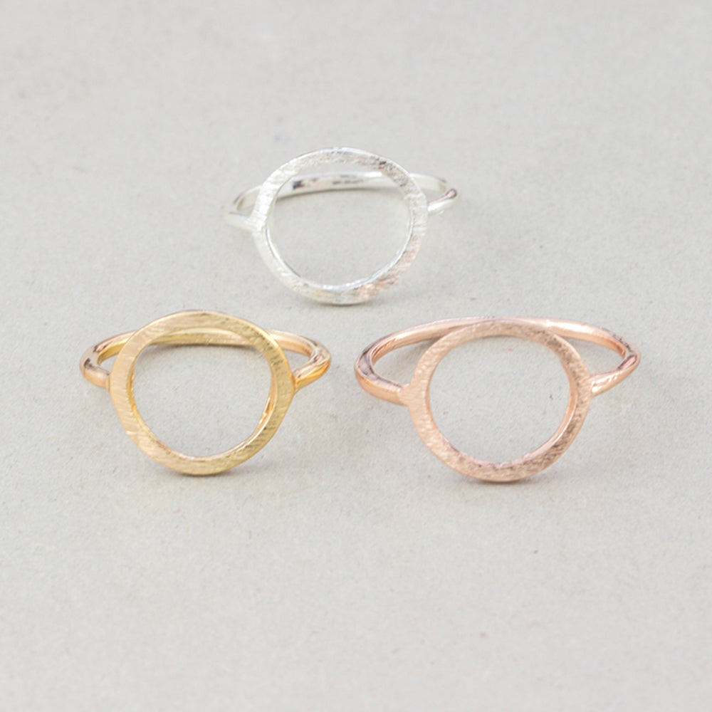 The Kelabu Karma Circle bohemian rings in all three different colours - gold, silver, and rose gold - on a light coloured background