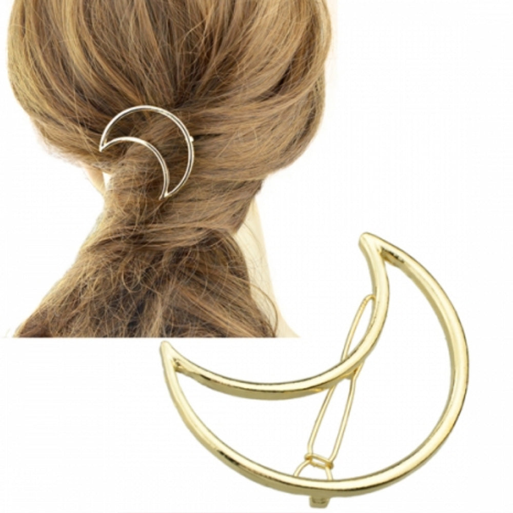 Woman with long blonde brown hair wearing the gold Kelabu cut out moon hair clip as a feature piece in a twisted ponytail