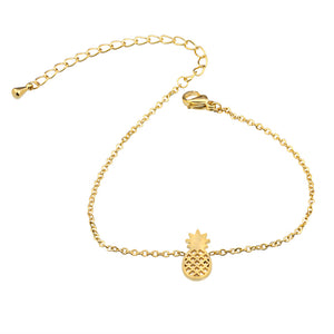 Cute gold pineapple bracelet from Kelabu on a white background