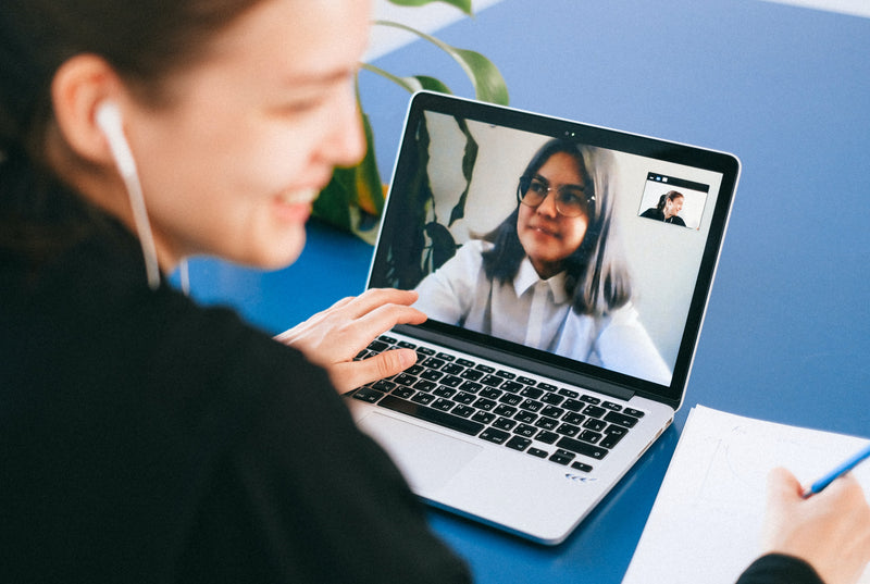 Student on a video call with a classmate.
