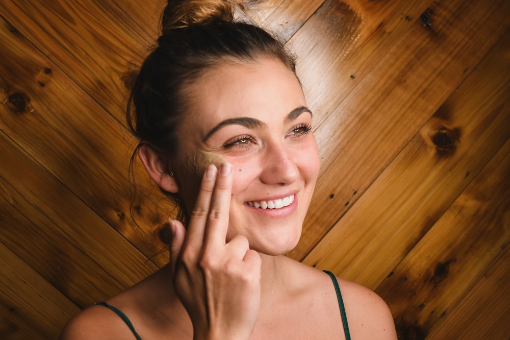 Woman smiling and washing her face
